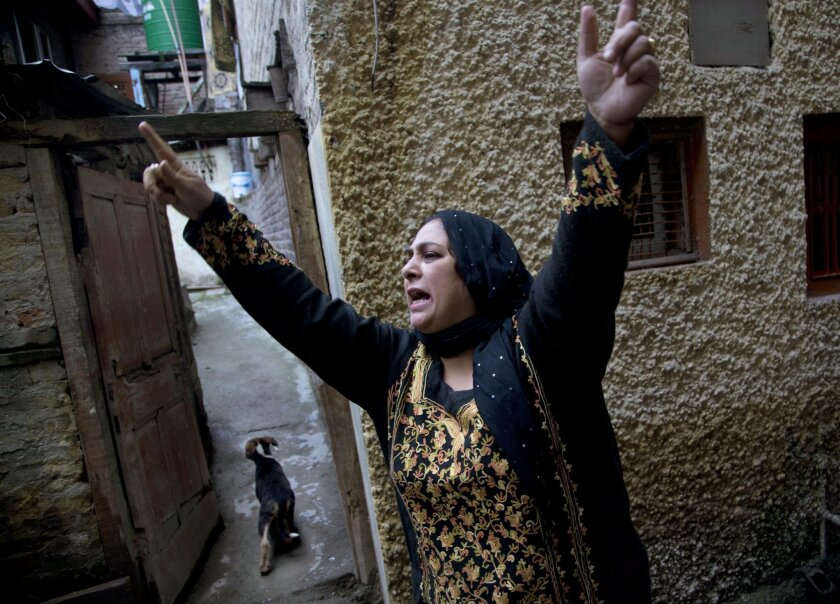 A Kashmiri Muslim woman shouts slogans after Indian police detained separatist People's Political Party (PPP) leader Hilal Ahmad War in Srinagar, Indian controlled Kashmir, Wednesday, Nov. 4, 2015. Indian authorities have detained key separatist leaders and hundreds of their supporters to prevent t