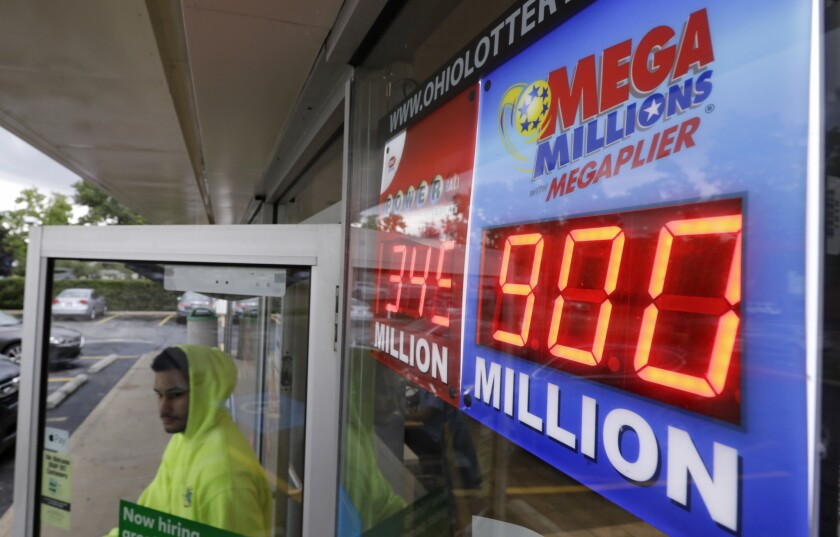 The Mega Millions jackpot is displayed as a customer leaves the Corner Market, Wednesday, Oct. 17, 2018, in Lyndhurst, Ohio. The next drawing will be Friday.