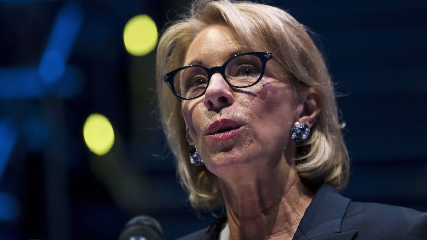 "Education Secretary Betsy DeVos regards the Obama-era rule, known as the borrower defense, as ""bad policy"" and will continue writing a new one, a department spokeswoman said."