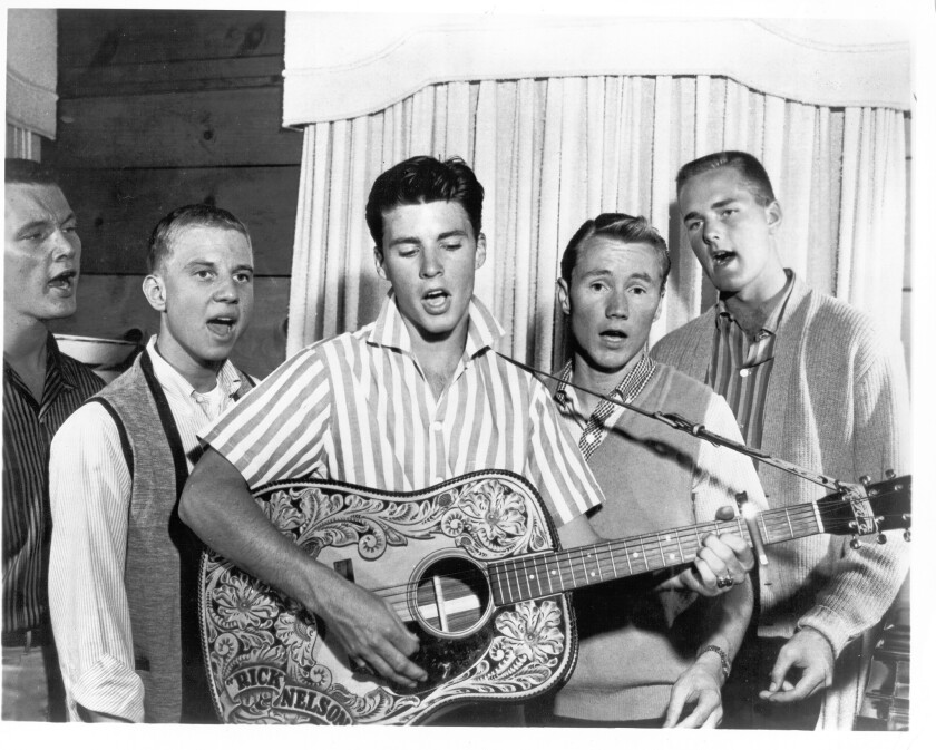 Before he became a TV writer and producer, Glen Larson (second from right) was a member of The Four Preps singing group, here backing up Ricky Nelson in Los Angeles in 1958.
