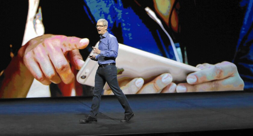 Apple chief Tim Cook sought to portray the company as a well-rounded tech firm branching beyond its successful smartphone. Early reaction among analysts was tepid, and Apple shares fell $2.16, or 1.9%.