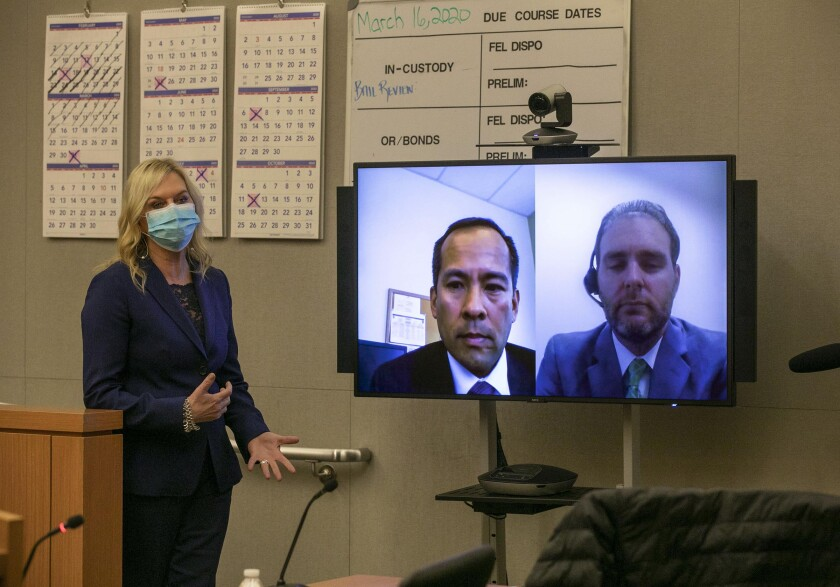 Presiding judge Lorna Alskne, left, held the first video court case in San Diego under the new COVID-19 pandemic on Monday. April 6, 2020. After the hearing and off the bench she answered questions from the media along with Deputy Public Defender Matthew Wechter, right of the screen, and Deputy District Attorney David Grapilon on the left.