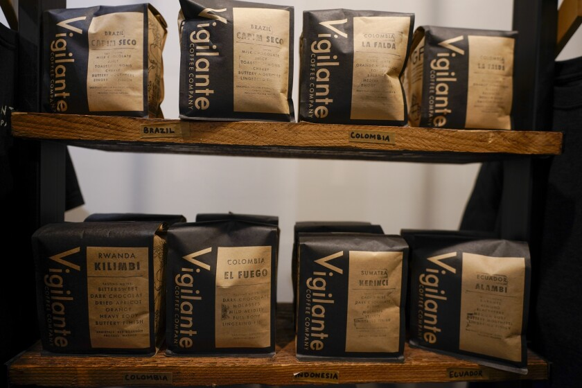 Bags of coffee are on display at Vigilante Coffee, Wednesday, Sept. 1, 2021, in College Park, Md. A confluence of supply chain problems, drought, frost and inflation all point to the price of your cup of morning coffee going up. The tricky part is trying to figure when — and how much. A sustained drought followed by two July frosts blew a hole in Brazil's coffee output, sending futures contract prices for the popular Arabica bean to near seven-year highs. (AP Photo/Julio Cortez)