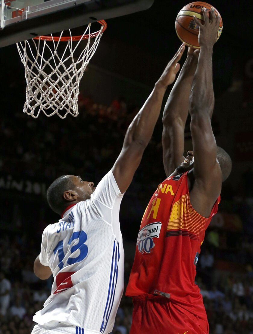 France's Boris Diaw, left, defends as Spain's Serge Ibaka shoots during the basketball World Cup quarter finals match between Spain and France in Madrid, Spain, Wednesday, Sept. 10, 2014. The 2014 Basketball World Cup competition will take place in various cities in Spain from Aug. 30 through to Sept. 14. (AP Photo/Daniel Ochoa de Olza)