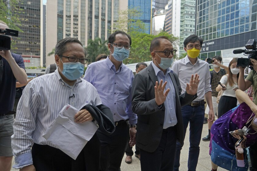 """Various defendants including pro-democracy activists, from left, Albert Ho, Richard Tsoi, Yeung Sum and Avery Ng arrive at a court in Hong Kong, Monday, May 17, 2021. Trial starts for Jimmy Lai and nine others, accused of """"incitement to knowingly take part in an unauthorized assembly"""" for a protest march on Oct. 1, 2019. The court has estimated 10 days for this trial. (AP Photo/Kin Cheung)"""