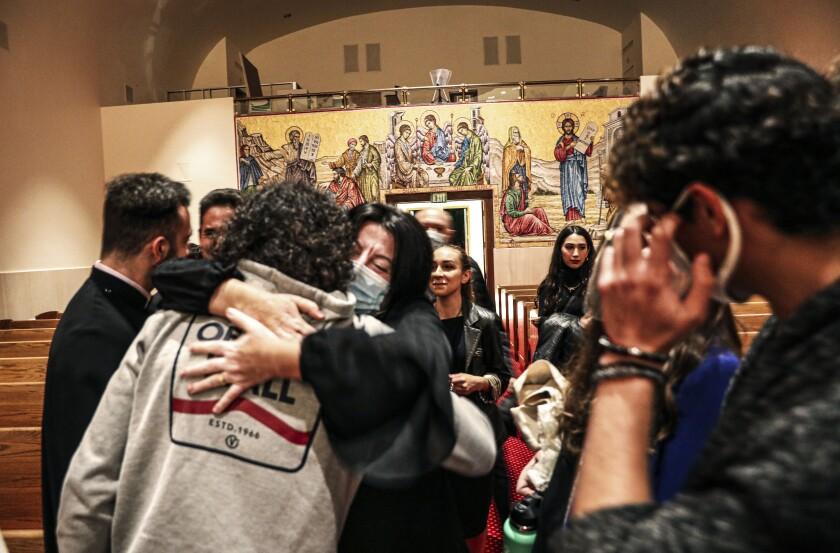 Anahit Chobanyan hugs another congregant