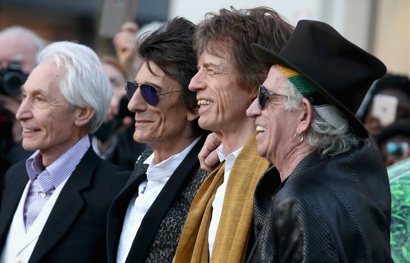 """Bandmates Charlie Watts, left, Ron Wood, Mick Jagger and Keith Richards arrive at the Saatchi Gallery in London for a preview of the show """"The Rolling Stones: Exhibitionism"""" on April 4, 2016."""