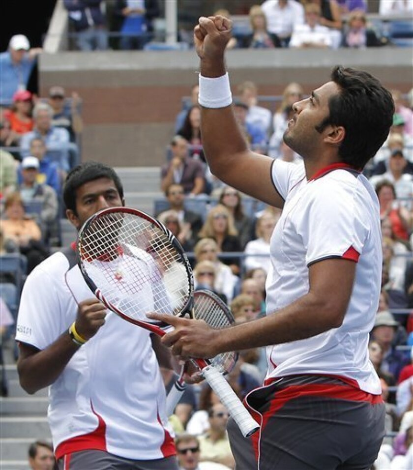 Aisam-Ul-Haq Qureshi of Pakistan, right, and partner Rohan Bopanna of India raise their fists during the men's doubles final at the U.S. Open tennis tournament in New York, Friday, Sept. 10, 2010. (AP Photo/Paul J. Bereswill)