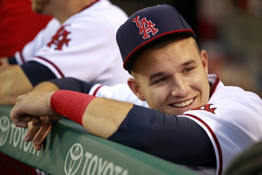 Mike Trout laughs with an Angels teammate in the dugout. The 22-year-old center fielder played in his second Major League All-Star Game in 2013.