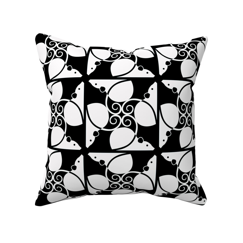Black-and-white rat-adorned throw pillow.