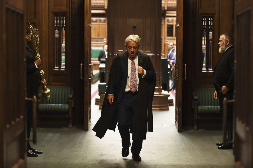 Speaker John Bercow leaves the British House of Commons on Oct. 31, 2019. The lower house speaker, who has become a global celebrity and online meme-magnet for his loud ties, even louder voice and star turn at the center of Britain's Brexit drama, stepped down on Oct. 31 after 10 years in the job.