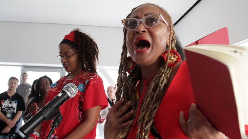 """Artists Nina Angela Mercer, left, and Elvira Clayton perform """"A Litany"""" as part of Black Women Artists for Black Lives Matter at the New Museum."""