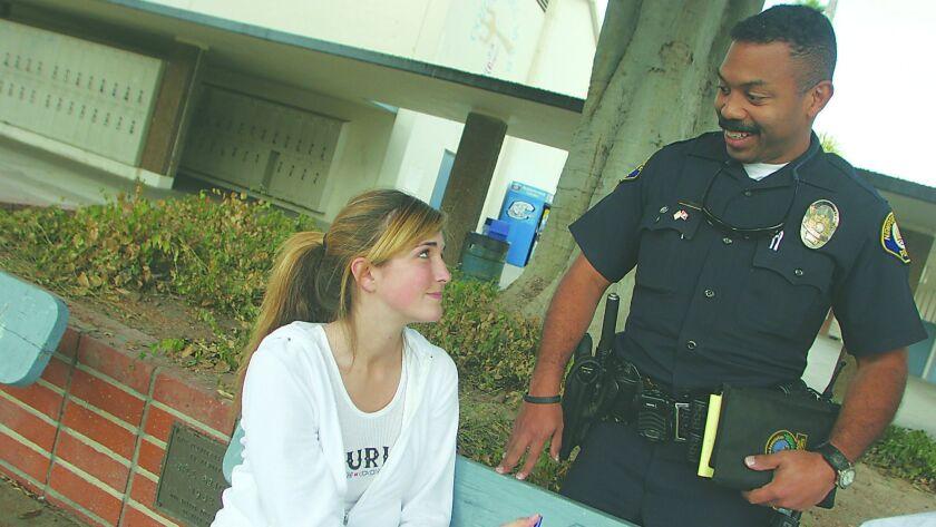 DPT.SRO16.1.121505.DZ Newport Beach police officer and school resource officer Vlad Anderson talks w