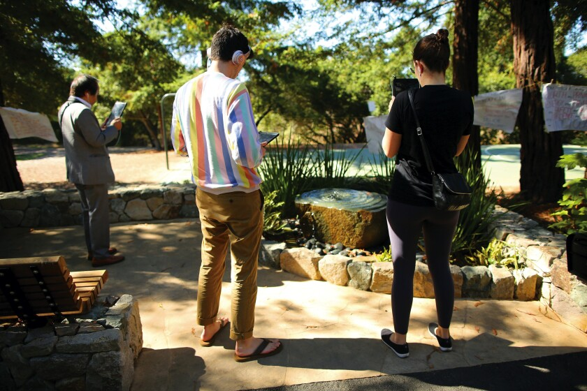 "Visitors to a ""healing garden"" on the Stanford University campus use an augmented-reality app that displays the words of Chanel Miller."