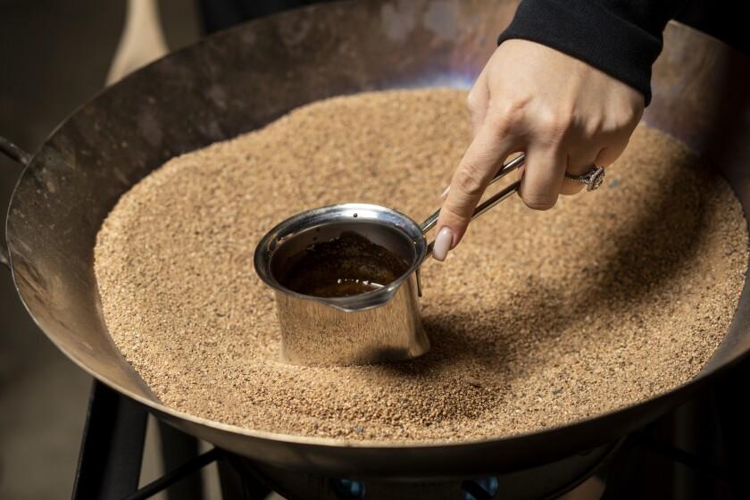Katie Kevorkian makes sand coffee at the Korner K'nafeh pop-up in Northridge.