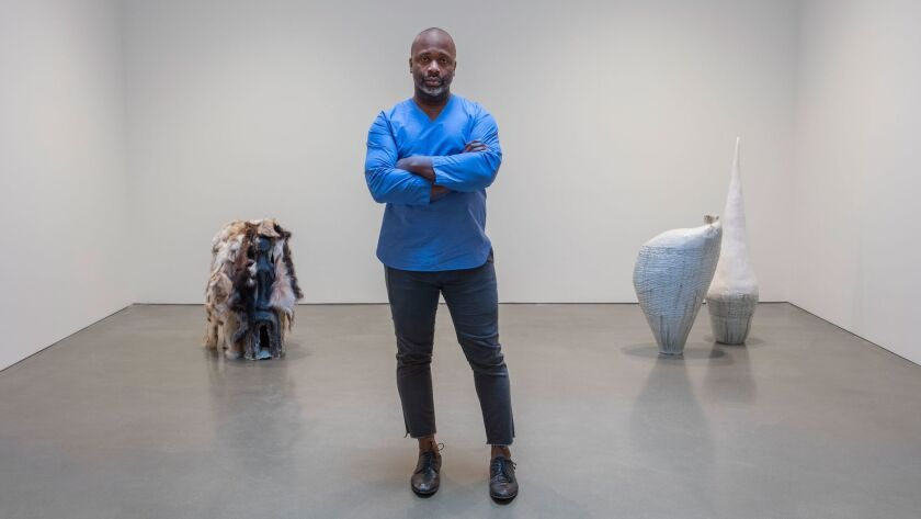Artist Theaster Gates stands amid his works at Regen Projects in Hollywood.