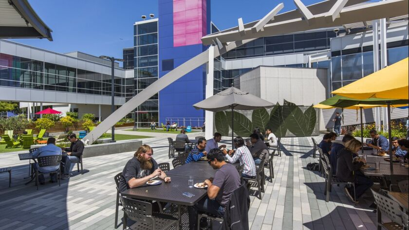 But where do they live? Google employees enjoy outdoor lunch at Google's headquarter complex in Mountain View.