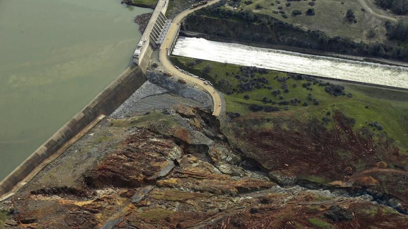 An aerial view shows the emergency spillway in the left part of this photo—a low concrete wall over which excess water spills over. Officials were alarmed that earth near the base of the concrete wall at Lake Oroville was rapidly eroding, which could cause the wall to collapse.