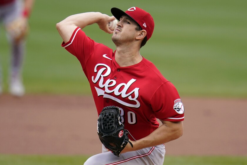 Cincinnati Reds starting pitcher Tyler Mahle delivers during the first inning of a baseball game against the Pittsburgh Pirates in Pittsburgh, Thursday, Sept. 16, 2021. (AP Photo/Gene J. Puskar)