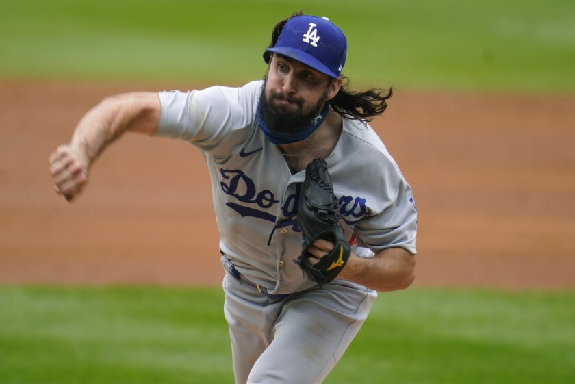 Dodgers starting pitcher Tony Gonsolin delivers during the first inning against the Colorado Rockies.
