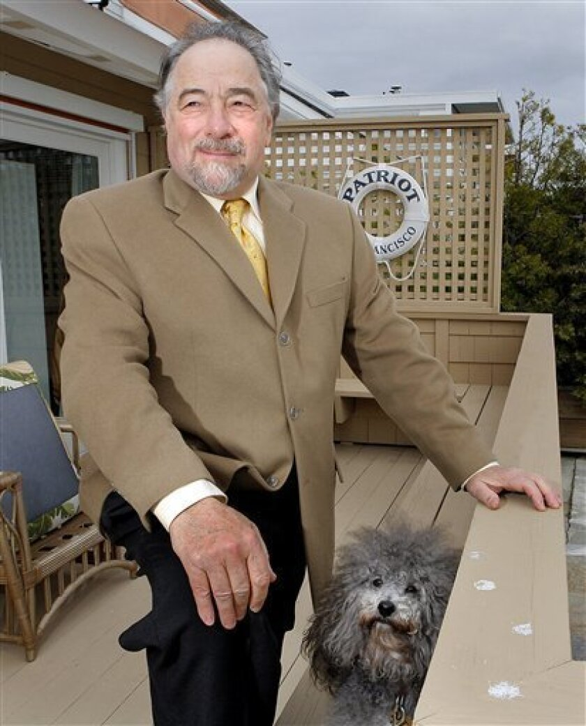 FILE - In this Dec. 3, 2007 file photo, radio talk show host Michael Savage poses with his dog Teddy in Tiburon, Calif. Savage won a legal battle Thursday Sept. 27, 2012 and announced he was leaving Talk Radio Network, which broadcast his show that attracted more than 8 million listeners a week. (A