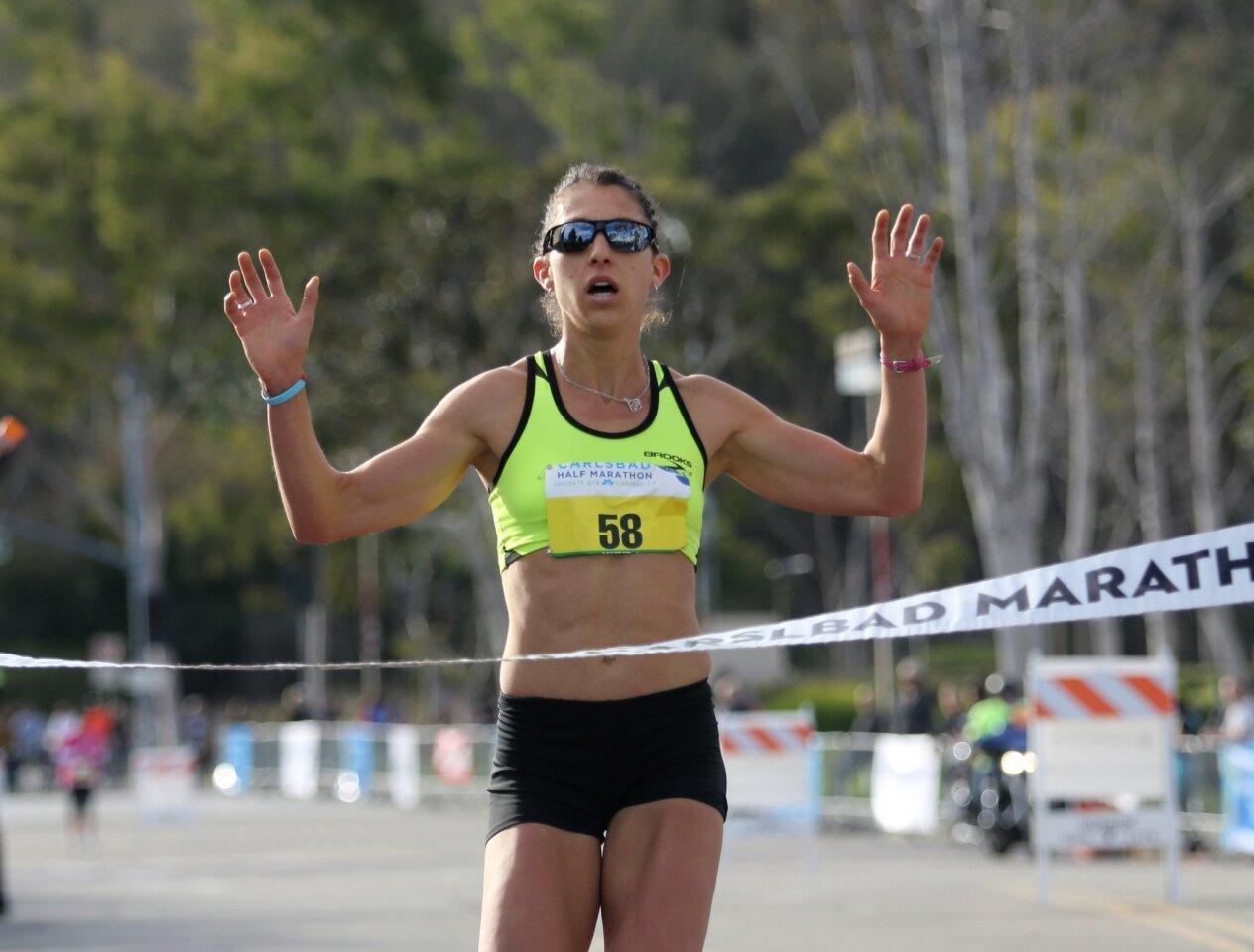 Natasha LaBeaud Anzures, of San Diego was the women's winner of the 2014 Tri-City Medical Center Carlsbad  Half Marathon.
