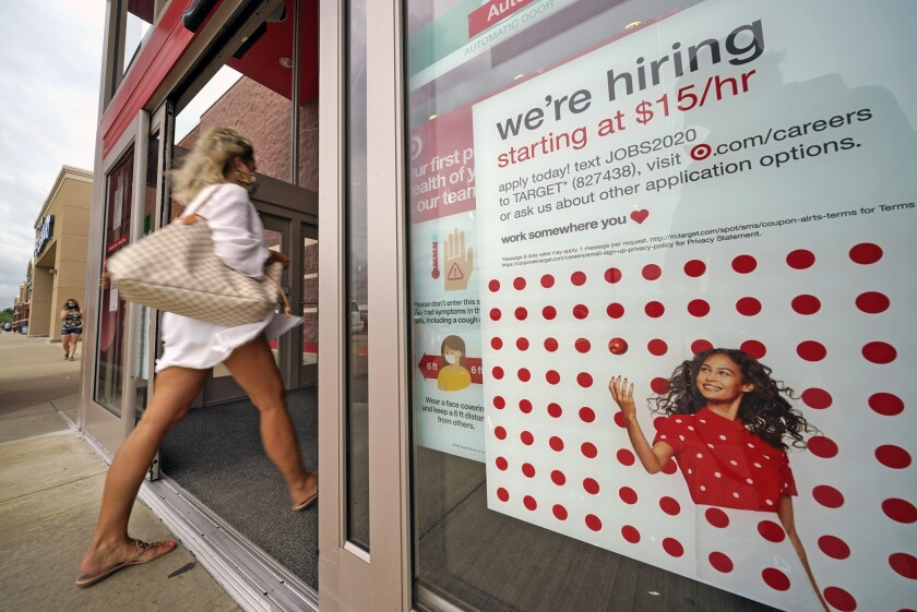 A help-wanted sign hangs on the door of a Target store in Uniontown, Pa.