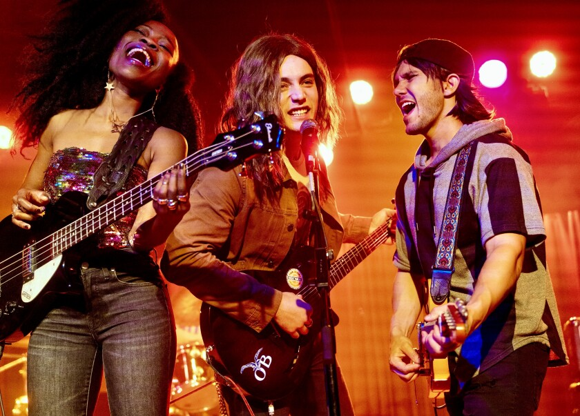 Bob Dylan's grandson, Levi Dylan, center, is flanked by actors Nana Ghana, left, and Carlos PenaVega, right, as they perform in the movie on the Belly Up stage in Solana Beach.