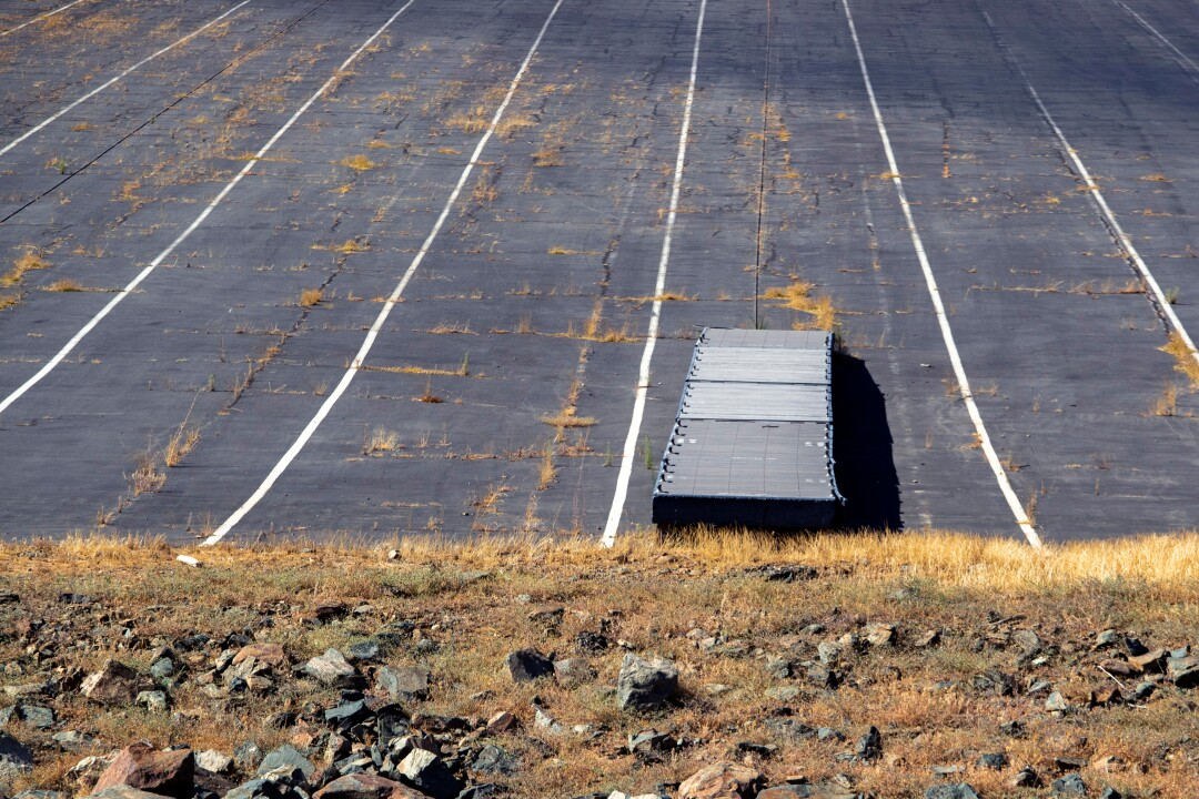 A boat dock is left high and dry on the shoreline at Lake Oroville.