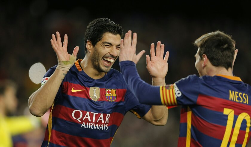 FC Barcelona's Luis Suarez, left, reacts after scoring with his teammate Lionel Messiagainst Celta Vigo during a Spanish La Liga soccer match at the Camp Nou stadium in Barcelona, Spain, Sunday, Feb. 14, 2016. (AP Photo/Manu Fernandez)