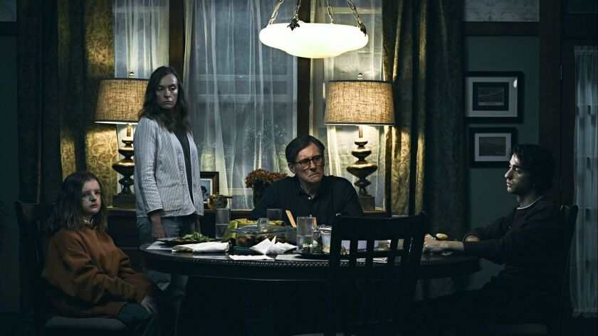 """(L-R) - Milly Shapiro, Toni Collette, Gabriel Byrne and Alex Wolff in a scene from """"Hereditary."""" Cr"""