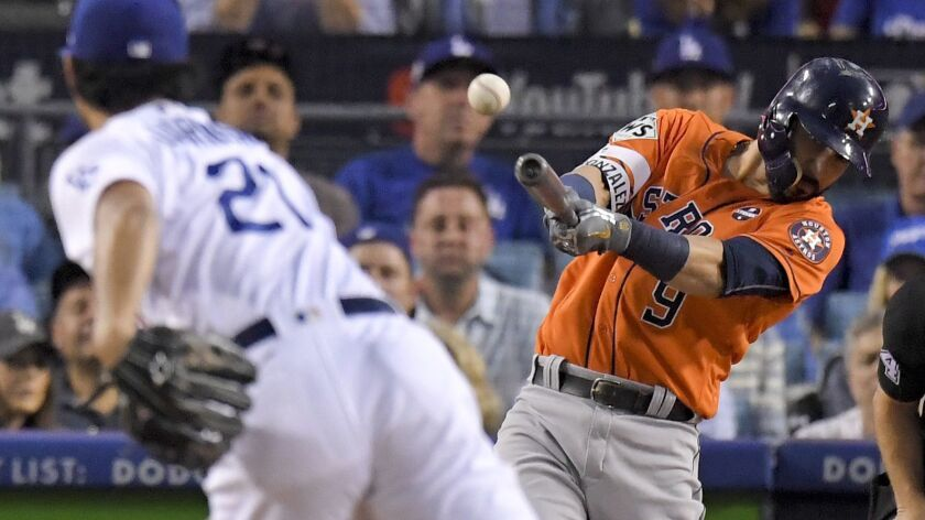 Marwin Gonzalez, here hitting a double for the Astros off Dodgers starting pitcher Yu Darvish in Game 7 of the 2017 World Series, is a proven winner.