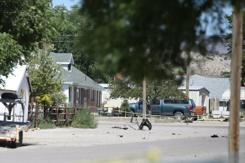 Shrapnel from a Wednesday night bombing that killed one person sits on a street in Panaca, Nev., on Thursday, July 14, 2016. (Brett Le Blanc/Las Vegas Review-Journal via AP)