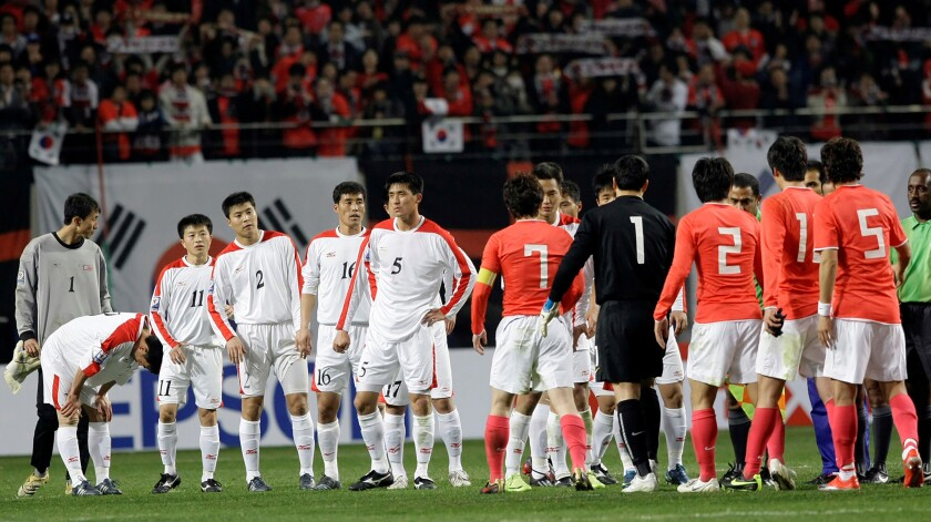 In this April 1, 2009, file photo, North Korean players, wearing white uniforms, shake hands with South Korean players