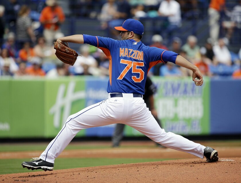 Cory Mazzoni, photographed Thursday, March 27, 2014, pitching for the Mets in Port St. Lucie, Fla. Mazzoni was traded to the Padres on Monday. (AP Photo/David Goldman)