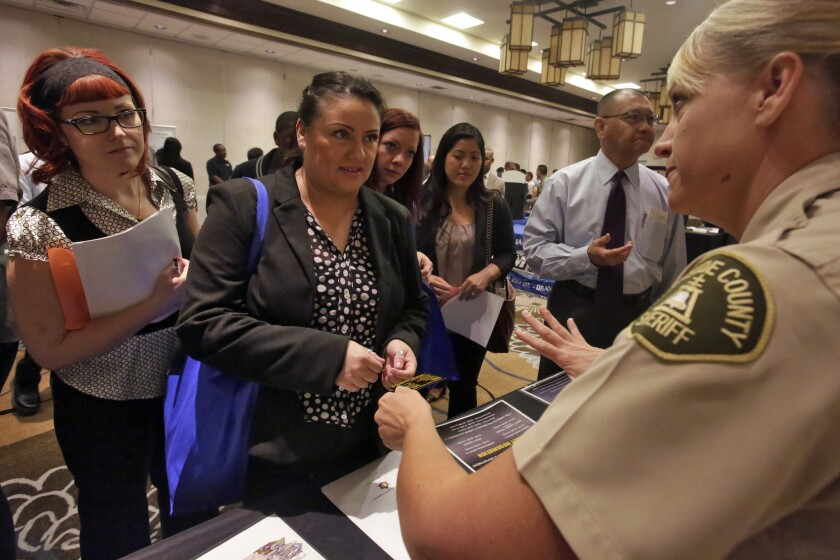Visitors to a career fair in the Inland Empire learn about potential jobs. There could be big changes in the workplace this year.