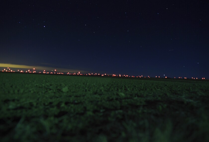 This Jan. 2, 2020, photo shows red lights from wind turbines in the distance in the area of Genoa and Hugo, Colo., where sightings of unidentified large drones in the air have been reported. An official investigation into reports of large drones flying in groups over the western U.S. plains in the hours after sunset has confirmed nothing illegal or out of the ordinary, a finding of little solace to folks who say the truth is still out there. Investigators will scale back flights of a heat-detecting plane to try to corroborate reports as they're made but will continue to look into new reports, Colorado officials said Tuesday, Jan. 14. (RJ Sangosti/The Denver Post via AP)