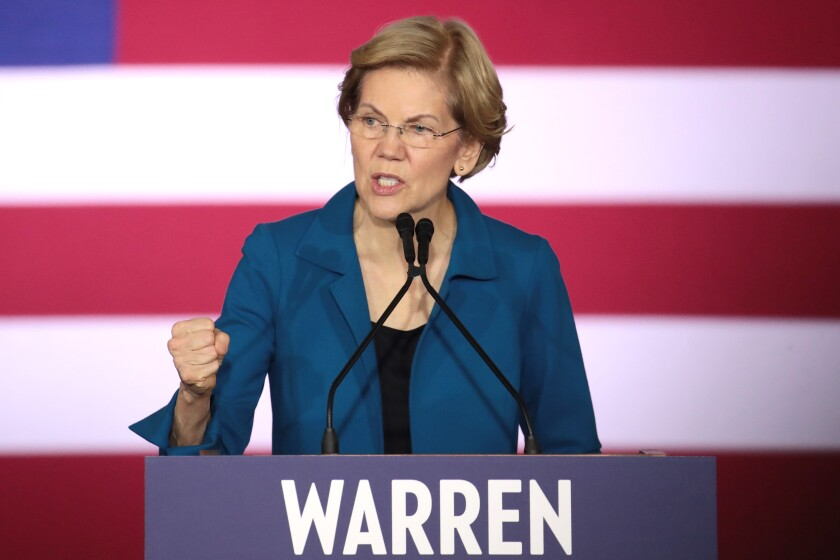 Elizabeth Warren again is pressed on past claims of Native American heritage