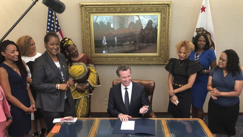 California Gov. Gavin Newsom, middle, signs State Bill, SB-188 Discrimination: hairstyles by state S