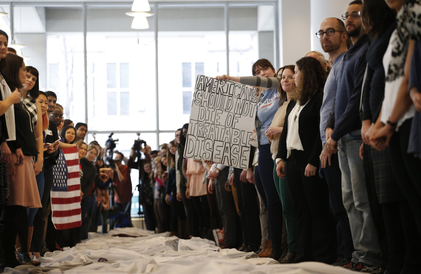 At the Northwestern University Lurie Research Center's Ryan Family Atrium, Northwestern medical students and faculty take part in a demonstration Jan. 30, 2017, in which they laid down their white coats to raise awareness about people who may lose their health insurance with changes to the Affordable Care Act.