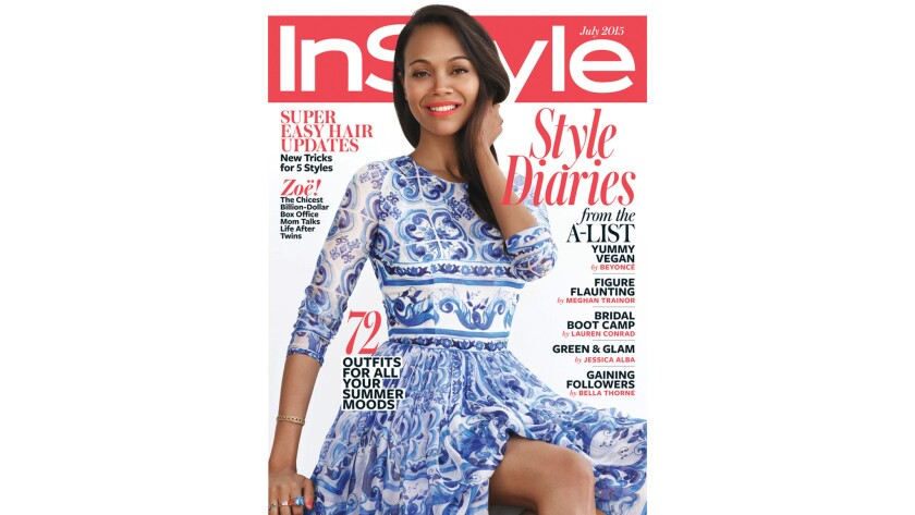 Actress Zoe Saldana appears on the July cover of InStyle wearing a Dolce & Gabbana dress, a bracelet and ring by Dior Fine Jewelry and other rings by Jane Taylor Jewelry.