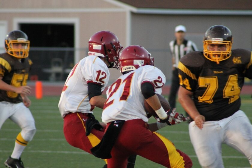 Falcon RB Michael Stearns (21) looks for daylight. Photo by Morgan Schreiber