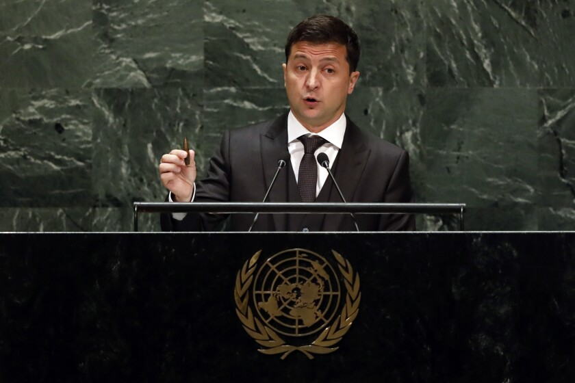 Ukraine's President Volodymyr Zelenskyy holds a bullet as he addresses the 74th session of the United Nations General Assembly, Wednesday, Sept. 25, 2019. (AP Photo/Richard Drew)