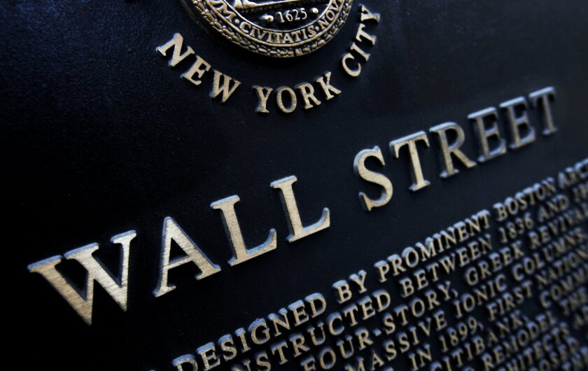 FILE - This Jan. 4, 2010 file photo shows an historic marker on Wall Street in New York. U.S. financial markets eased back from record highs in early trading Wednesday, Feb. 25, 2015. (AP Photo/Mark Lennihan, File)