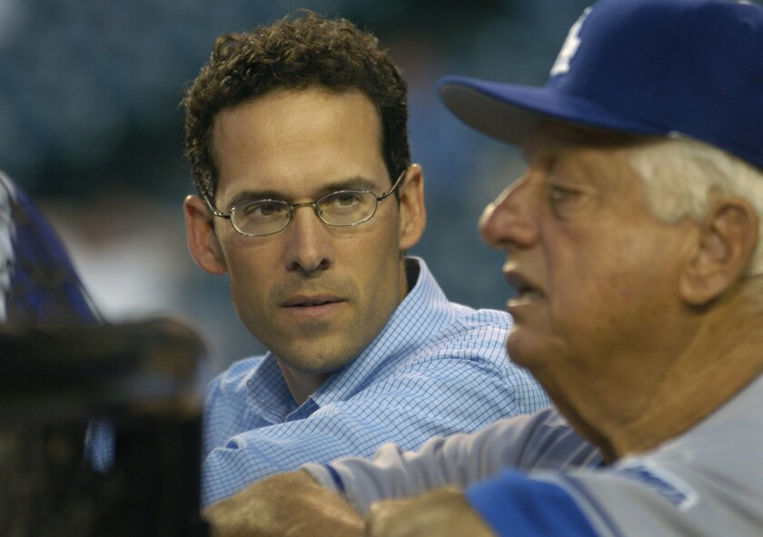 Then-Dodgers general manager Paul DePodesta talks with Tommy Lasorda during batting practice on April 1, 2005.