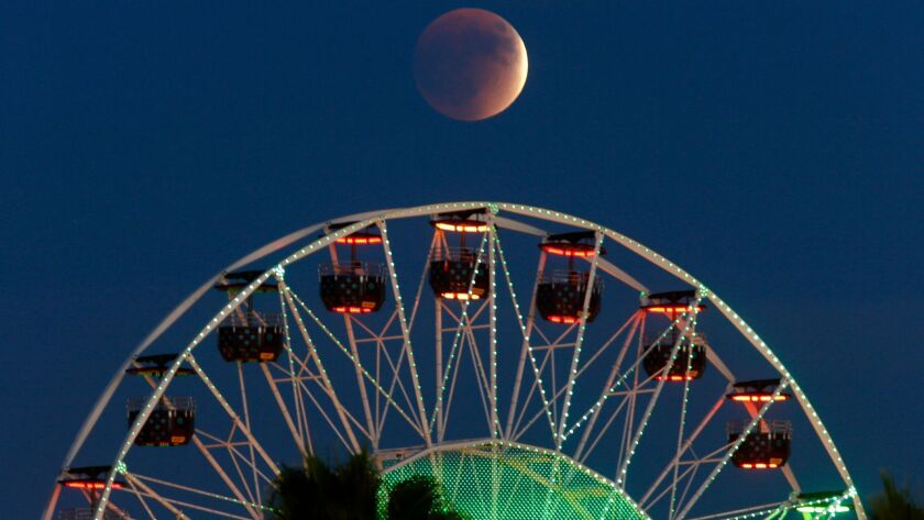 """SEPTEMBER 27, 2015. IRVINE, CA. The """"super moon"""" is nearly in total eclipse on September 27, 2015("""
