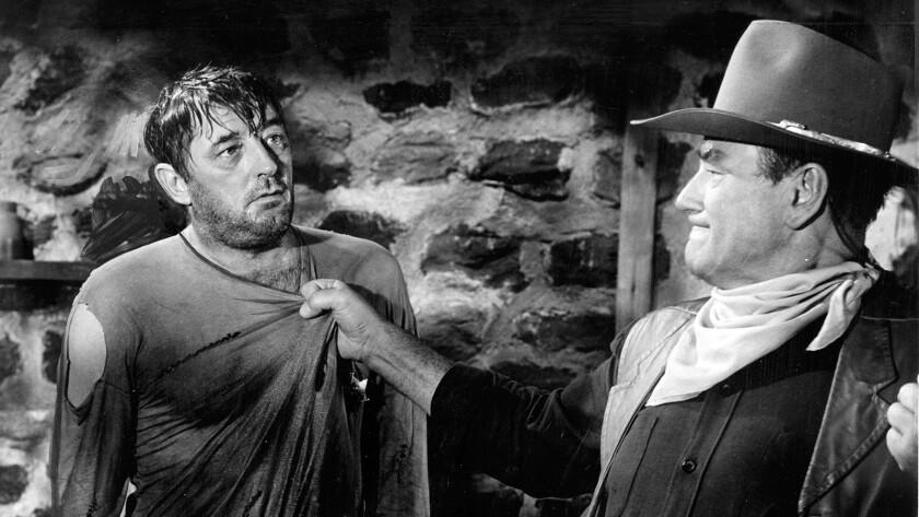 "Robert Mitchum, left, and John Wayne in the 1967 film ""El Dorado."""