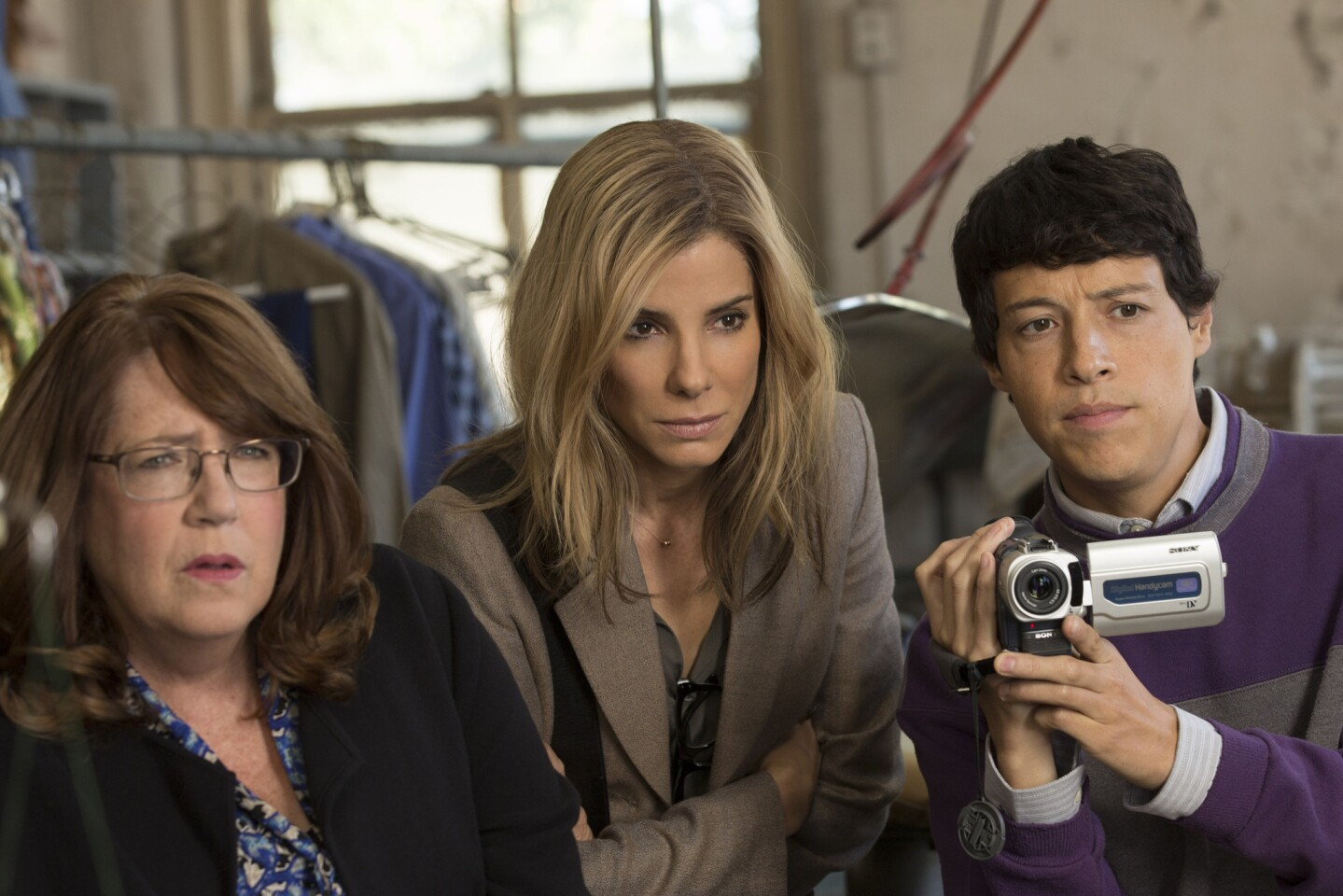 "Ann Dowd, left, portrays Nell, Sandra Bullock is Jane and Reynaldo Pacheco is Eddie in ""Our Brand Is Crisis."""