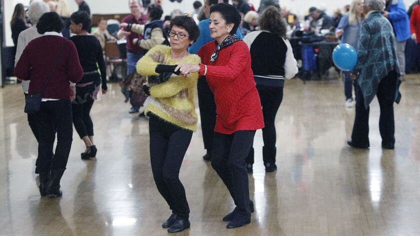 Lilly Chen, of North Hollywood, and Rikki Varton, of Burbank, dance together at a sock hop, one of s