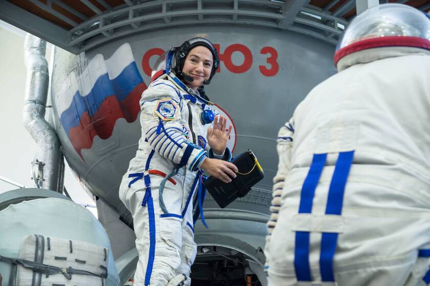 At the Gagarin Cosmonaut Training Center in Star City, Russia, Expedition 61 crewmember Jessica Meir of NASA climbs aboard a Soyuz trainer during final crew qualification exams Aug. 30. Meir will launch with Expedition 61 crewmember Oleg